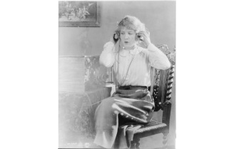 Woman with headphones listening to radio broadcast between ca. 1920 and ca. 1930 Photo by Underwood & Underwood, courtesy Photo courtesy Library of Congress Prints and Photographs Division Washington, D.C. https://www.loc.gov/item/2012649424/