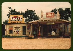 "A cross roads store, bar, ""juke joint,"" and gas station in the cotton plantation area, Melrose, La., June 1940."