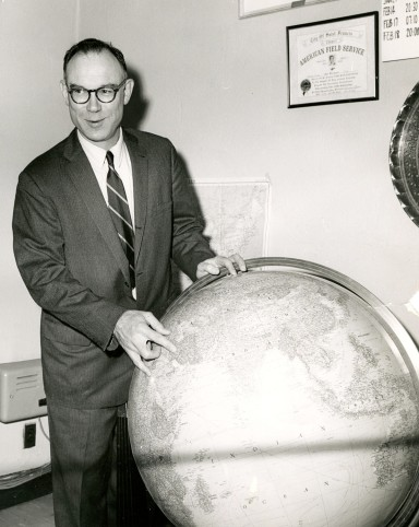 Arthur Howe, Jr. pointing to Iran on a globe during his AFS presidency in 1967. Several years later he traveled to Abbasabad, Iran to give a speech about AFS and its role in international education. Photo courtesy of the Archives of the American Field Service and AFS Intercultural Programs.