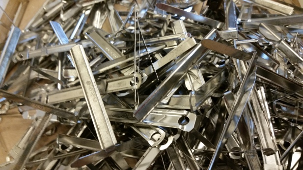 Staples, clips and other fasteners removed from Refugee Resettlement Office files during processing. Photo courtesy the Archives of The Episcopal Diocese of Olympia.