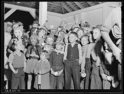 Halloween party at Shafter migrant camp, California, November 1938. Photo by Dorothea Lange, courtesy U.S. Farm Security Administration/Office of War Information/Office of Emergency Management/Resettlement Administration Black & White Photographs, Library of Congress Prints and Photographs Division Washington, D.C. http://www.loc.gov/pictures/item/2017770943/
